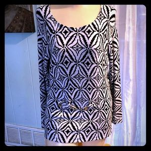 Wide neck knit blouse with silver buckle accent.